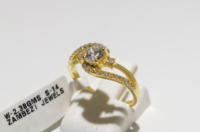 Engagement yellow gold and diamond split shank, offset ring with crystals