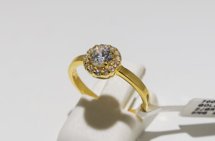 Engagement yellow gold 9k and halo swarovski crystal ring