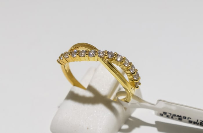 Engagement yellow gold and diamond interlocked ring shank
