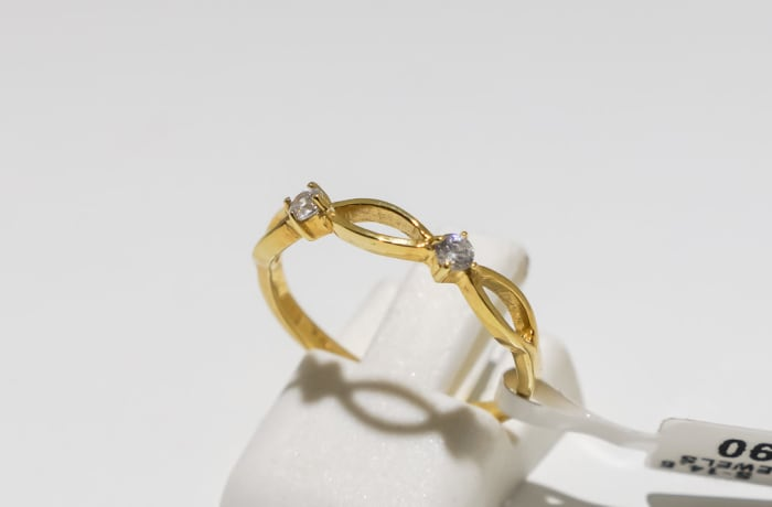 Engagement yellow gold 9k and 2-crystal inter-linked ring