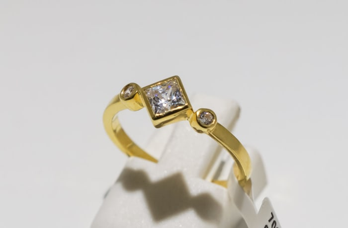 Engagement yellow gold 9k and crystal ring with square gem and two crystals
