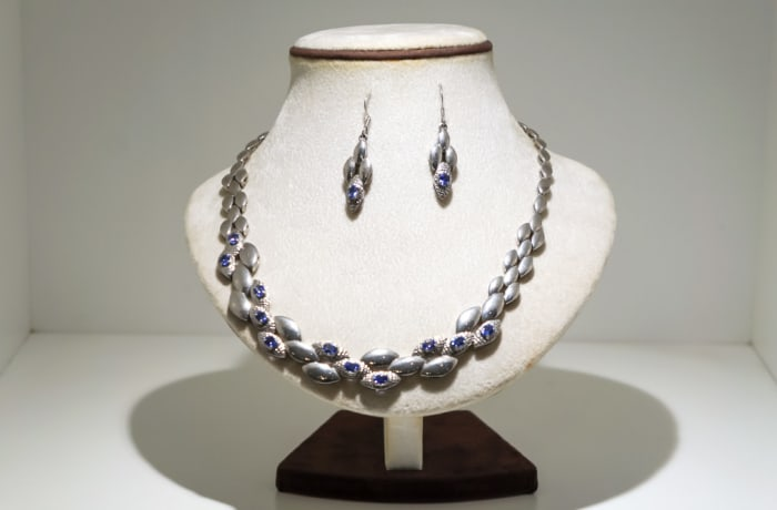 Silver and white gold plated petals with tanzanite gemstones necklace and  earring set
