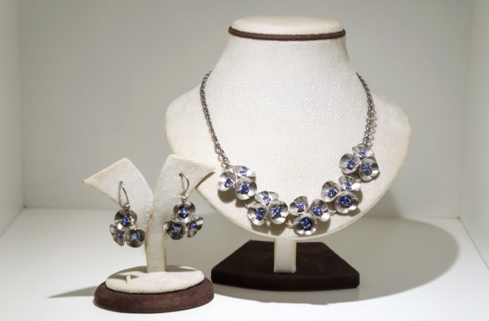Silver and tanzanite plated with white gold flowers necklace and earring set