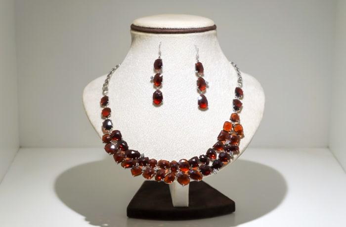 Silver oval garnet gem earring and necklace set