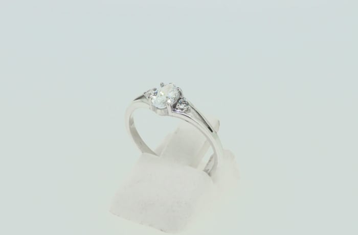 Engagement silver solitaire crystal ring on 'V' split
