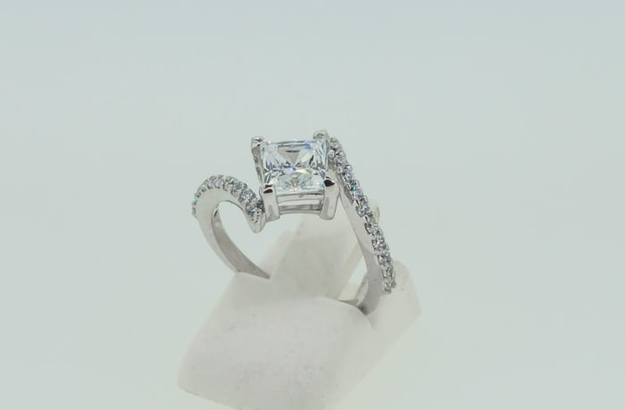 Engagement silver tension held with crystals ring