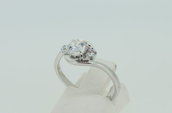 Engagement silver and 3-crystal tension clasp ring