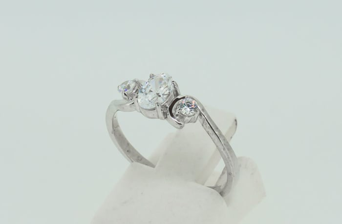 Engagement silver and 3 brilliant round crystals ring