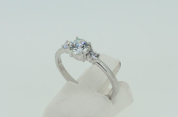 Solitaire engagement silver and three crystals ring