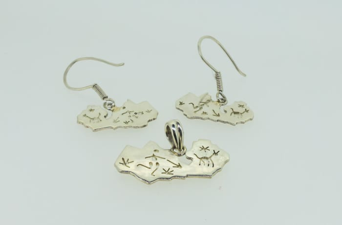 Silver map of Zambia pendant and earrings with traditional hunting engraving