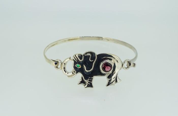 Silver bangle with elephant