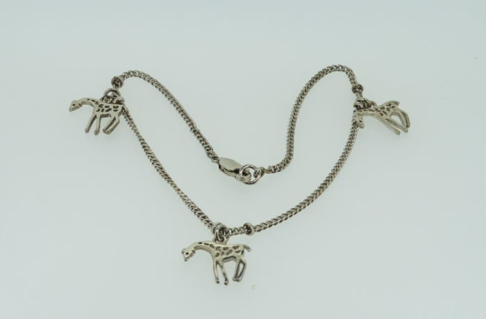 Silver necklace with giraffes