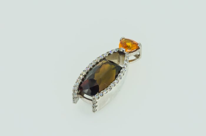 Amber and crystals pendant
