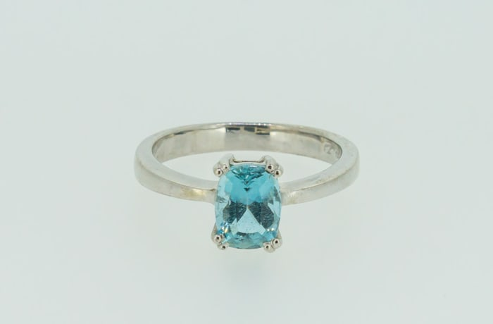 White gold crown set sapphire engagement ring