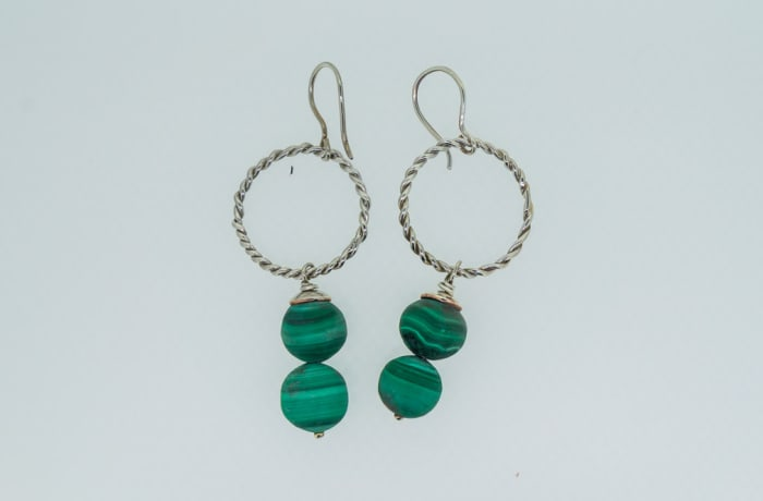 Silver earrings on twisted ring with hanging malachite gemstones