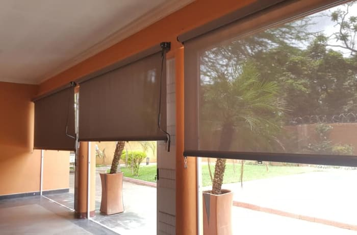 Outdoor awnings that control the sun and rain on your veranda image