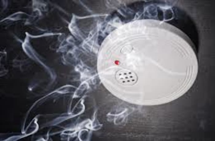 Installs and services smoke detection systems image