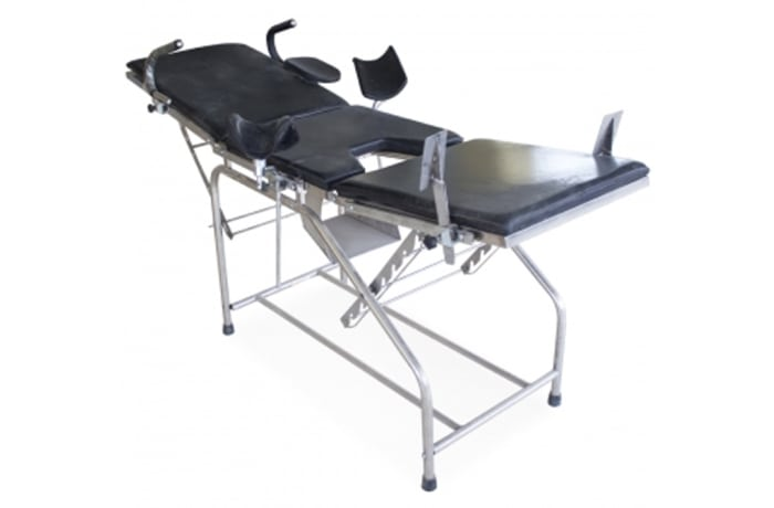 Examination table with leg holder