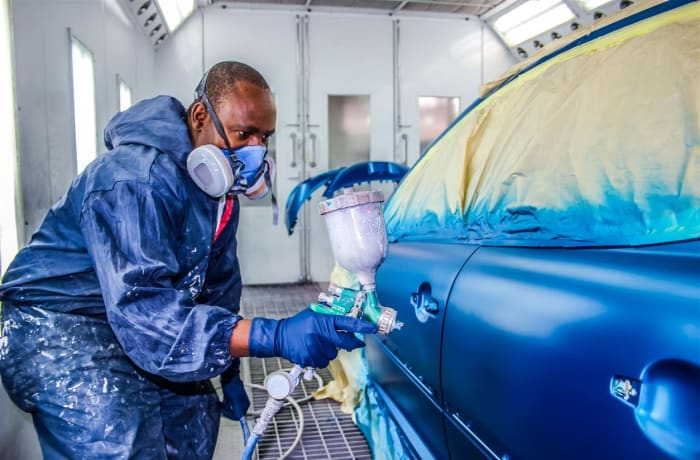 Car panel beating and spray painting image