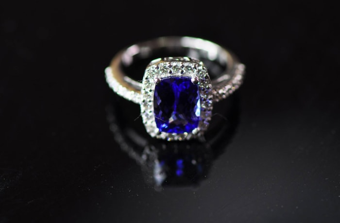 Tanzanite Ring in White Gold , surrounded by Diamonds