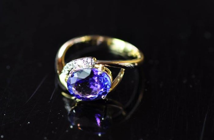 Ring - Women's Gold ring with Tanzanite  embedded in Diamonds