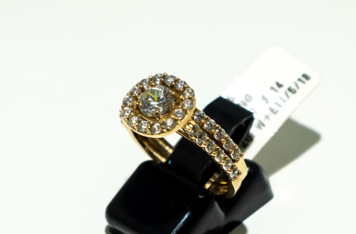 Yellow gold 9k halo engagement ring with crystals