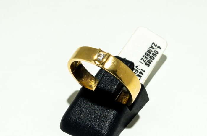 Gold men's wedding band with a diamond