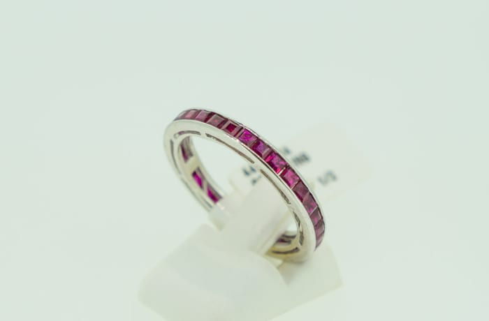 Channel setting white gold 14k wedding band with ruby gemstones