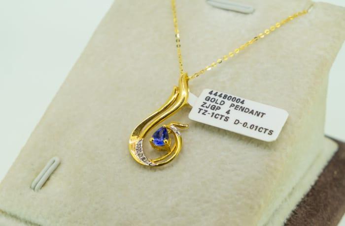 Yellow gold 18k and tanzanite with diamond treble clef pendant