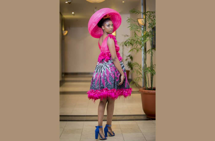 Chitenge dress with sleeveless pink top and feather fringe