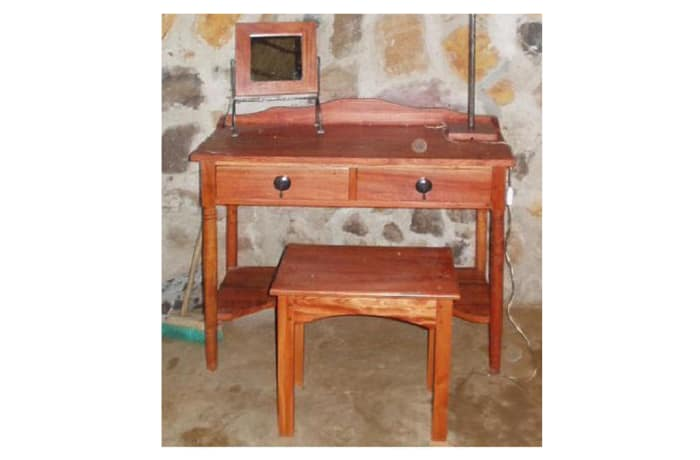 Dressing table with steel trim and knockers