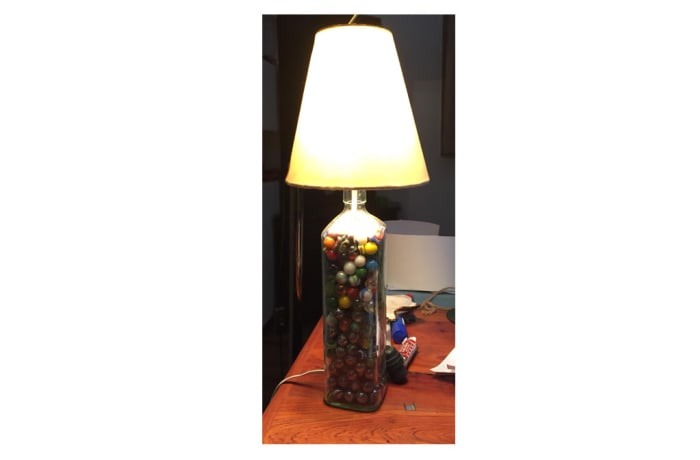 Lamp shade on bottle with marbles