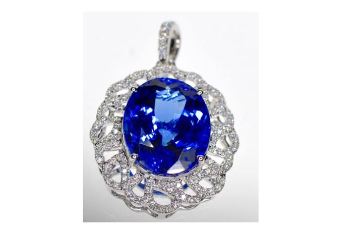 Tanzanite Oval Pendant in White Gold , surrounded by Diamonds