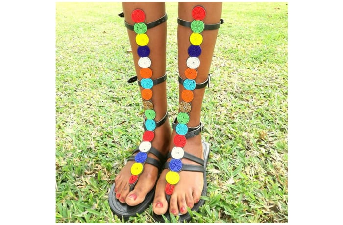 Black leather gladiator sandals with beads