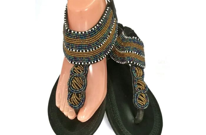 Black leather sandals with gold black and white beads
