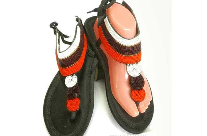 Black leather sandals with orange, black and white beads