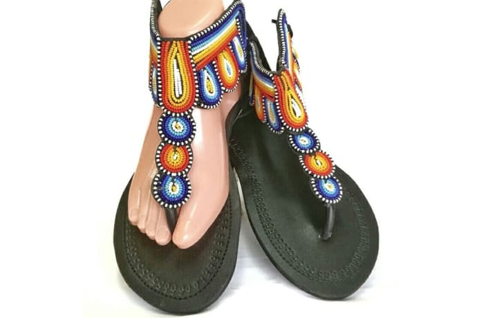 Black leather sandals with orange, blue and white beads