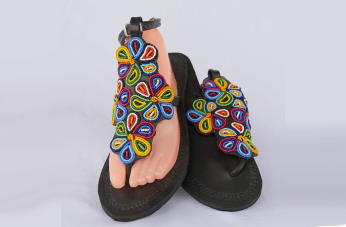 Black leather sandals with flowers of beads