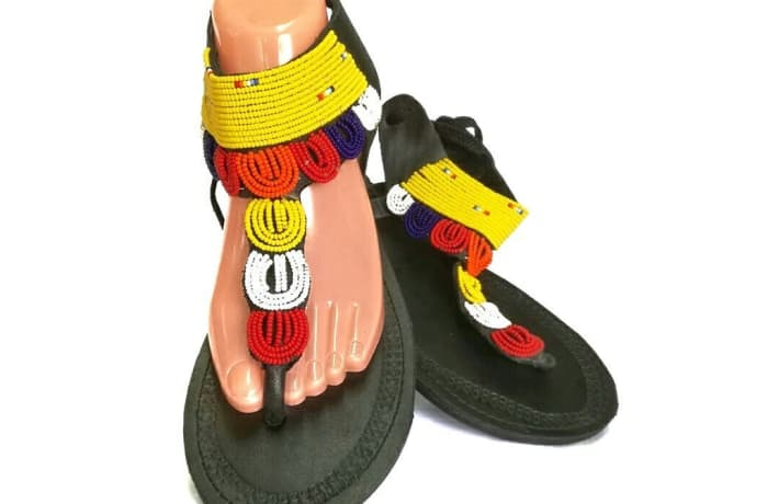 Black leather sandals with yellow, orange and white beads