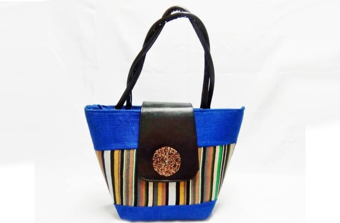 Blue fabric and black leather handbag