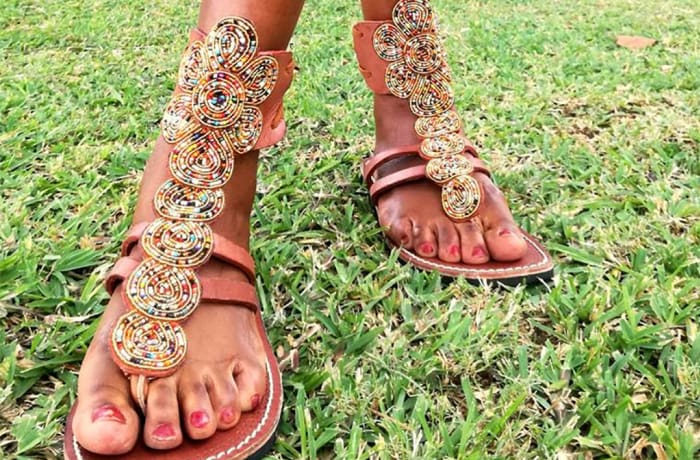 Brown leather ankle high sandals with beads