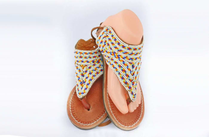 Brown leather sandals with white beads