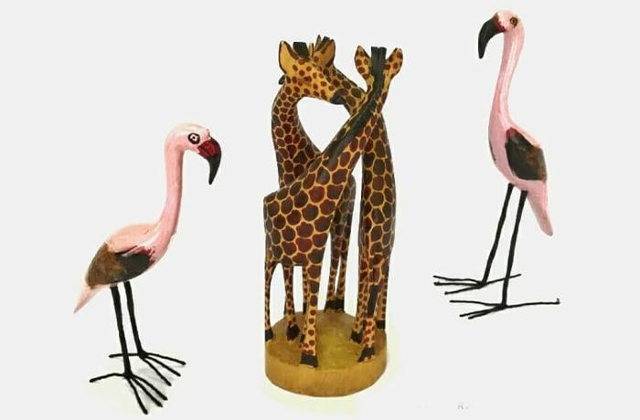 Wooden flamingo & giraffe carvings