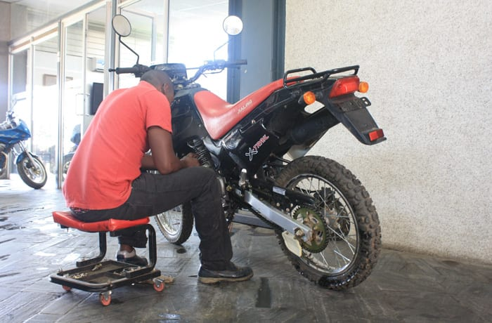 Fully equipped workshop for servicing and repairs of different motorcycle brands image