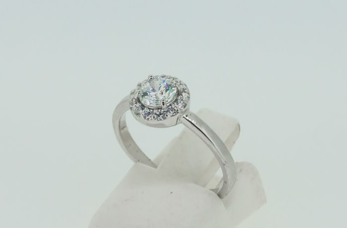 Engagement silver and crystal halo ring with crystals image