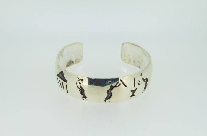 Silver bangle with traditional African art image