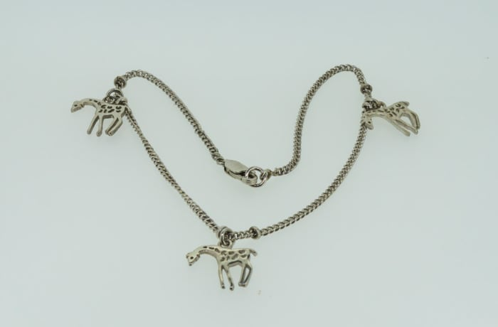 Silver necklace with giraffes image