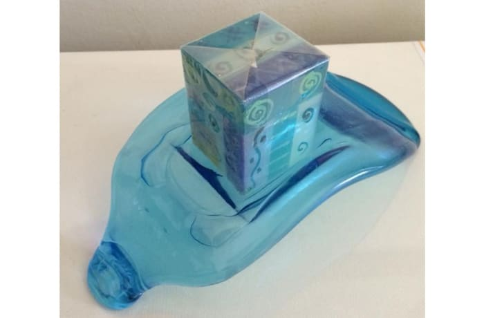 Blue flattened paper weight bottle image