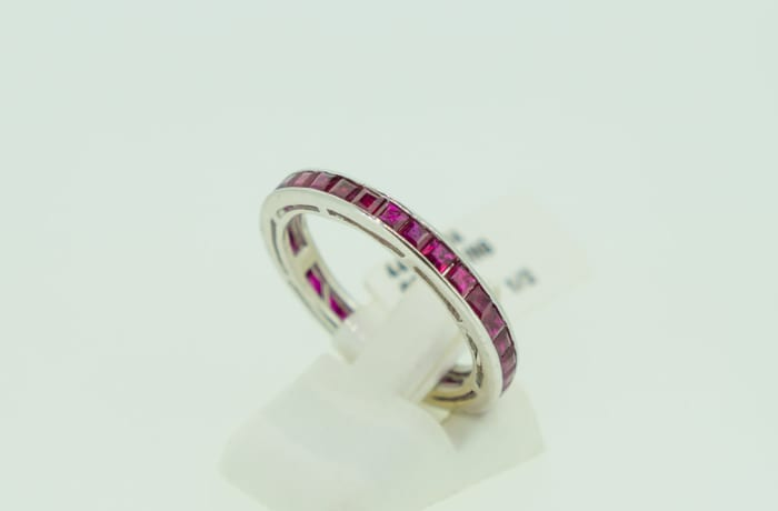Channel setting white gold 14k wedding band with ruby gemstones image
