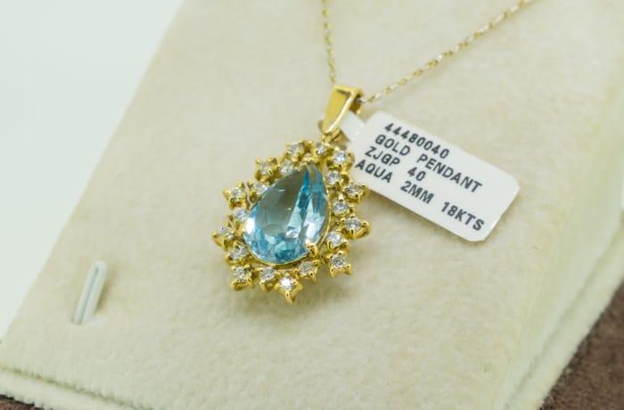 Yellow gold 18k aquamarine teardrop stone and crystal pendant image